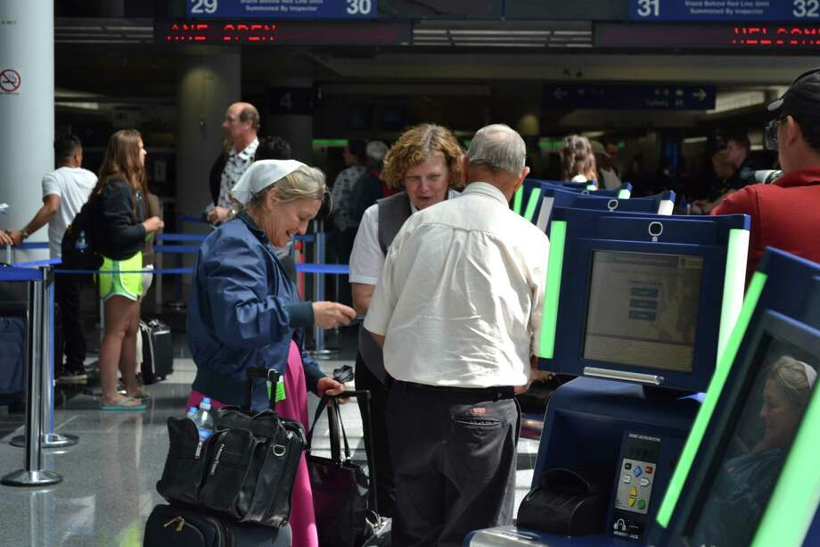 Travelers using new kiosks at Chicago O'Hare International Airport after arriving back in the United States. The new technology was installed in ensure shorter wait times when flying internationally. Photo: Customs And Border Protection / ONLINE_YES