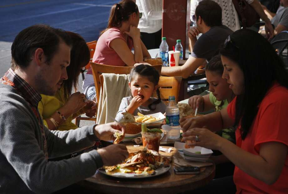 Luna Randall (center) enjoys lunch with her family at Tarantino's in San Francisco. Photo: Raphael Kluzniok, The Chronicle