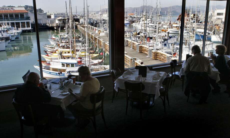 Patrons enjoy the waterfront view and lunch at Tarantino's in San Francisco. Photo: Raphael Kluzniok, The Chronicle