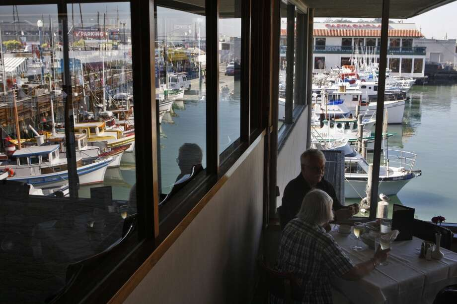 Gillian and Bruce Bennett of Scotland enjoy the waterfront view and lunch at Tarantino's Photo: Raphael Kluzniok, The Chronicle