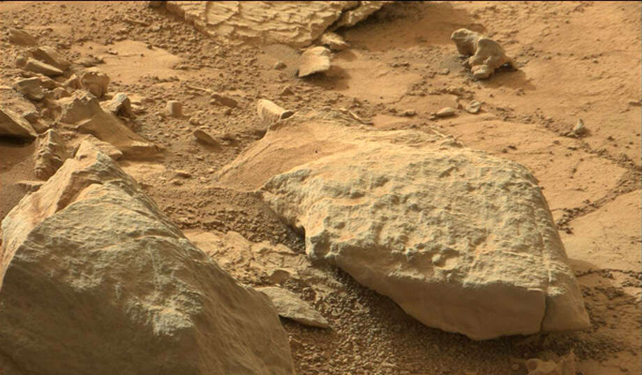 Zooming in to this original NASA photo here will reveal where another blogger claims to have spotted an iguana on Mars.