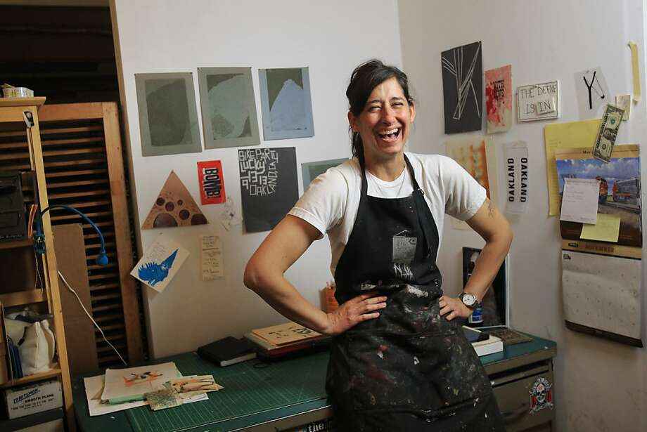 """Above: Defne Beyce works in her Compound Gallery space during the opening of """"TextMessage."""" Photo: Leah Millis, The Chronicle"""
