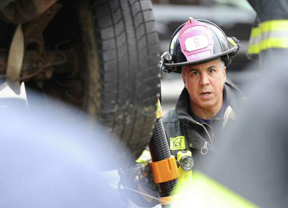 Greenwich firefighter Tom Pitasi trains with the department's new rescue equipment, the Paratech HydraFusion Struts, at a simulated two vehicle crash scene at the Sound Beach Fire Department in Old Greenwich, Tuesday, Nov. 12, 2013. Deputy Chief, Keith Millette, said the new gear is the state of the art in vehicle stabilization equipment and can be used to lift heavy vehicles at accident scenes. Photo: Bob Luckey / Greenwich Time