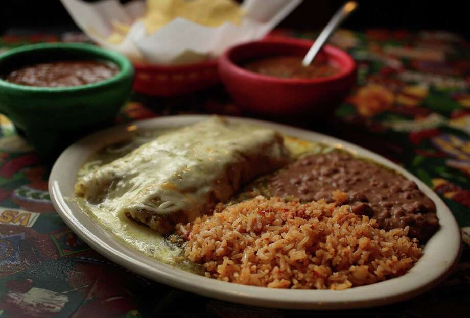 Lupita's Mexican Restaurant's green chicken enchiladas are full of tart tomatillo and cilantro. Photo: Karen Warren, Staff / © 2013 Houston Chronicle