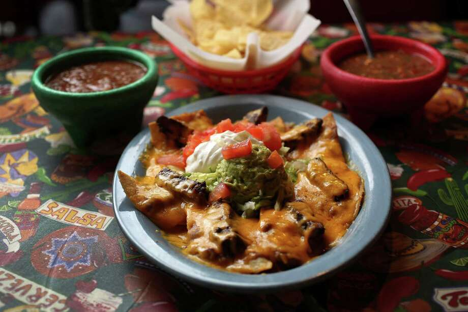 Mercy's Nachos come with a choice of beef or chicken fajitas with refried beans and either Monterey Jack or cheddar cheese). Photo: Karen Warren, Staff / © 2013 Houston Chronicle
