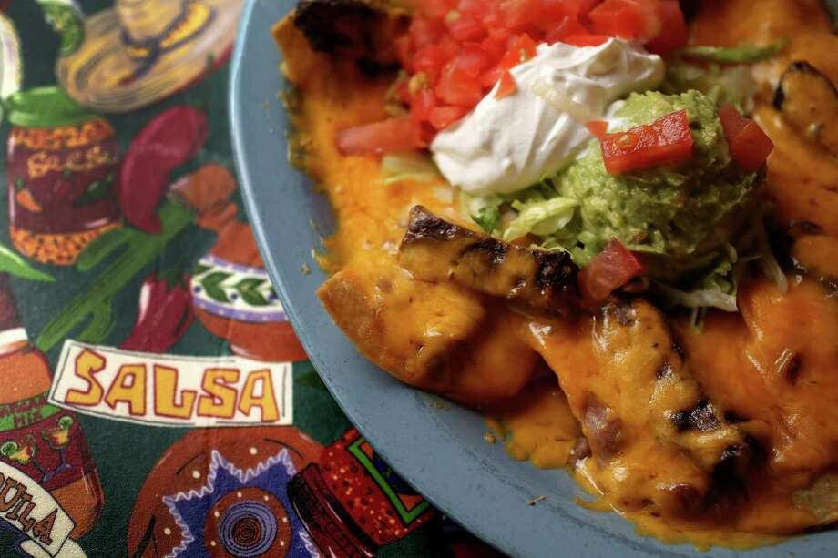A plate of Mercy's Nachos (choice of beef or chicken fajitas topped with refried beans and choice of Monterey or Cheddar Cheese) at Lupita's Mexican Restaurant, Wednesday, Nov. 6, 2013, in Sugar Land. ( Karen Warren / Houston Chronicle ) Photo: Karen Warren, Staff / © 2013 Houston Chronicle