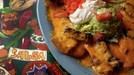 A plate of Mercy's Nachos (choice of beef or chicken fajitas topped with refried beans and choice of Monterey or Cheddar Cheese) at Lupita's Mexican Restaurant, Wednesday, Nov. 6, 2013, in Sugar Land. ( Karen Warren / Houston Chronicle )