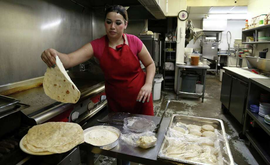 Maria Lourdes makes flour tortillas at Lupita's Mexican Restaurant. They're so good, they elevate every dish in which they're used. Photo: Karen Warren, Staff / © 2013 Houston Chronicle