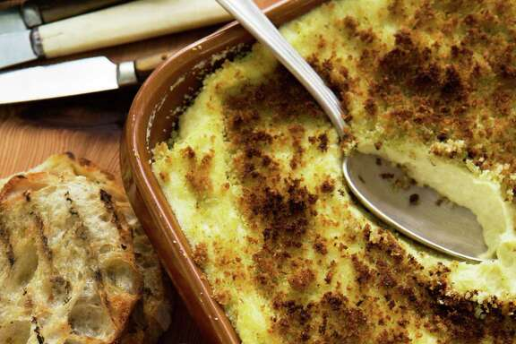 """John Besh's """"Cooking From the Heart: My Favorite Lessons Learned Along the Way"""" includes Brandade de Morue au Gratin."""