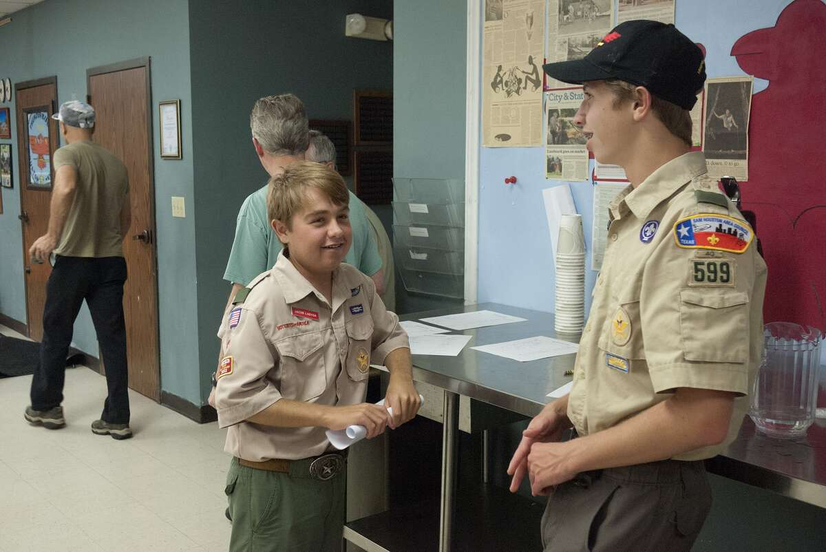Jacob Ladyga, 16, center, chats with Ernie Reguera, 15, at a Boy Scout Troop 599 meeting at Memorial United Methodist Church. Despite problems related to a failing kidney, Jacob has been active in sports and Scouts.