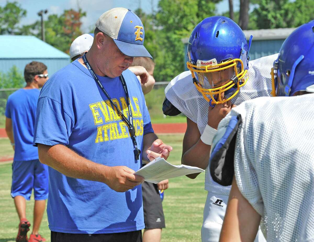 Evadale head coach Mark Williams (left) gives directions to a player during a practice. Enterprise file photo