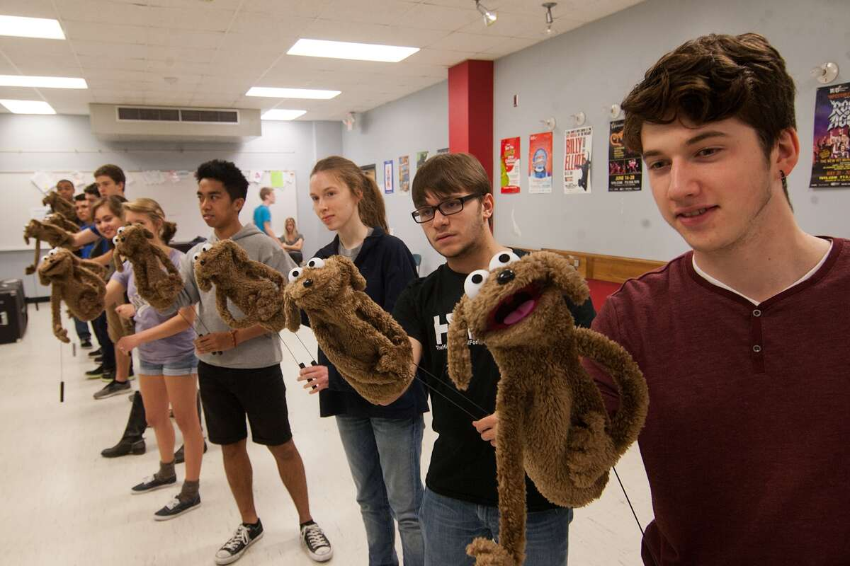 """In preparation for the """"Avenue Q"""" production, students work on a """"reaction and motion"""" exercise during a """"puppet camp"""" taught by a puppet coordinator from the show's post-Broadway production in Las Vegas."""