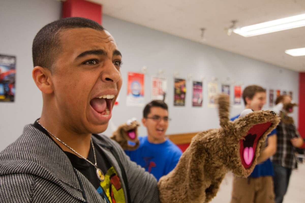 """Dante Rossi and his puppet participate in an exercise while training for the High School for the Performing and Visual Arts production of """"Avenue Q."""""""