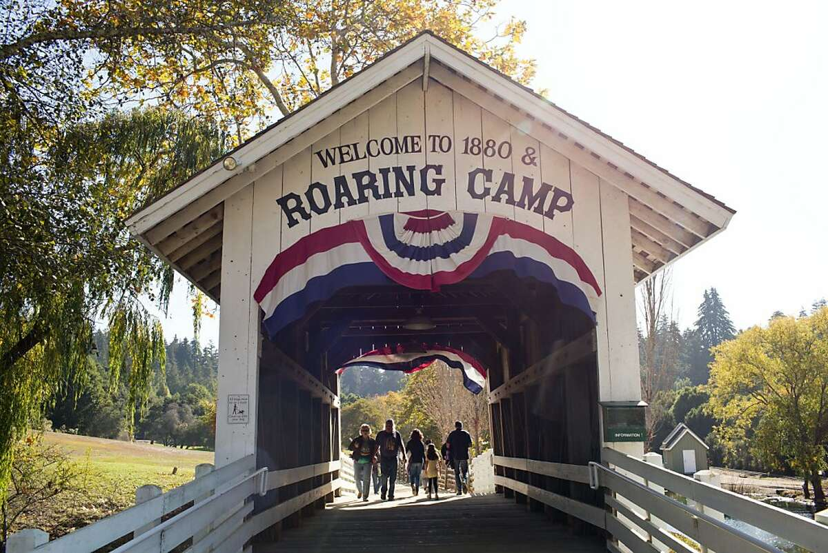Guests cross a covered bridge upon arrival to the Roaring Camp Railroad, which will offer a Holiday Light Train running for a two hour trip from Santa Cruz to Felton, Calif., Saturday October 9, 2013.