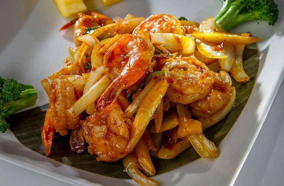 Rangoon Ruby's mango shrimp ($21) is a simple stir-fry dish, adding basil, onions and mango puree to the shrimp; fresh mango is served on the side. Photo: John Storey, Special To The Chronicle