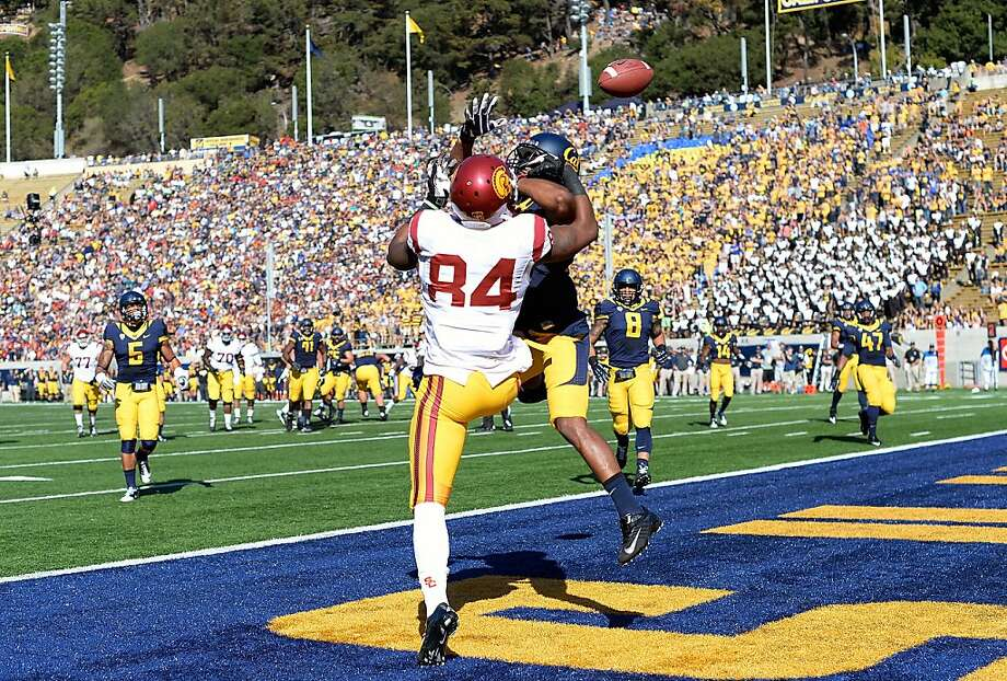 Cal cornerback Cedric Dozier breaks up a pass to USC's Darreus Rogers on Saturday. Photo: Thearon W. Henderson, Getty Images