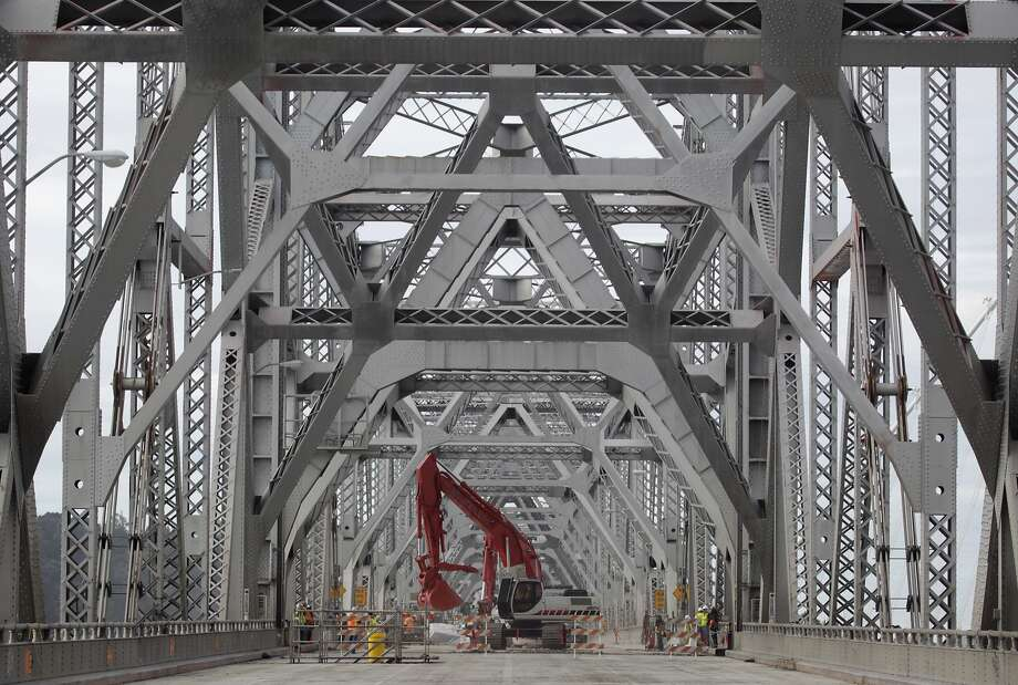 A demolition crew removes a section of westbound lanes on the old eastern span of the Bay Bridge in Oakland, Calif. on Tuesday, Nov. 12, 2013. If all goes as planned, the deconstruction work is scheduled to be completed by late 2016 Photo: Paul Chinn, The Chronicle