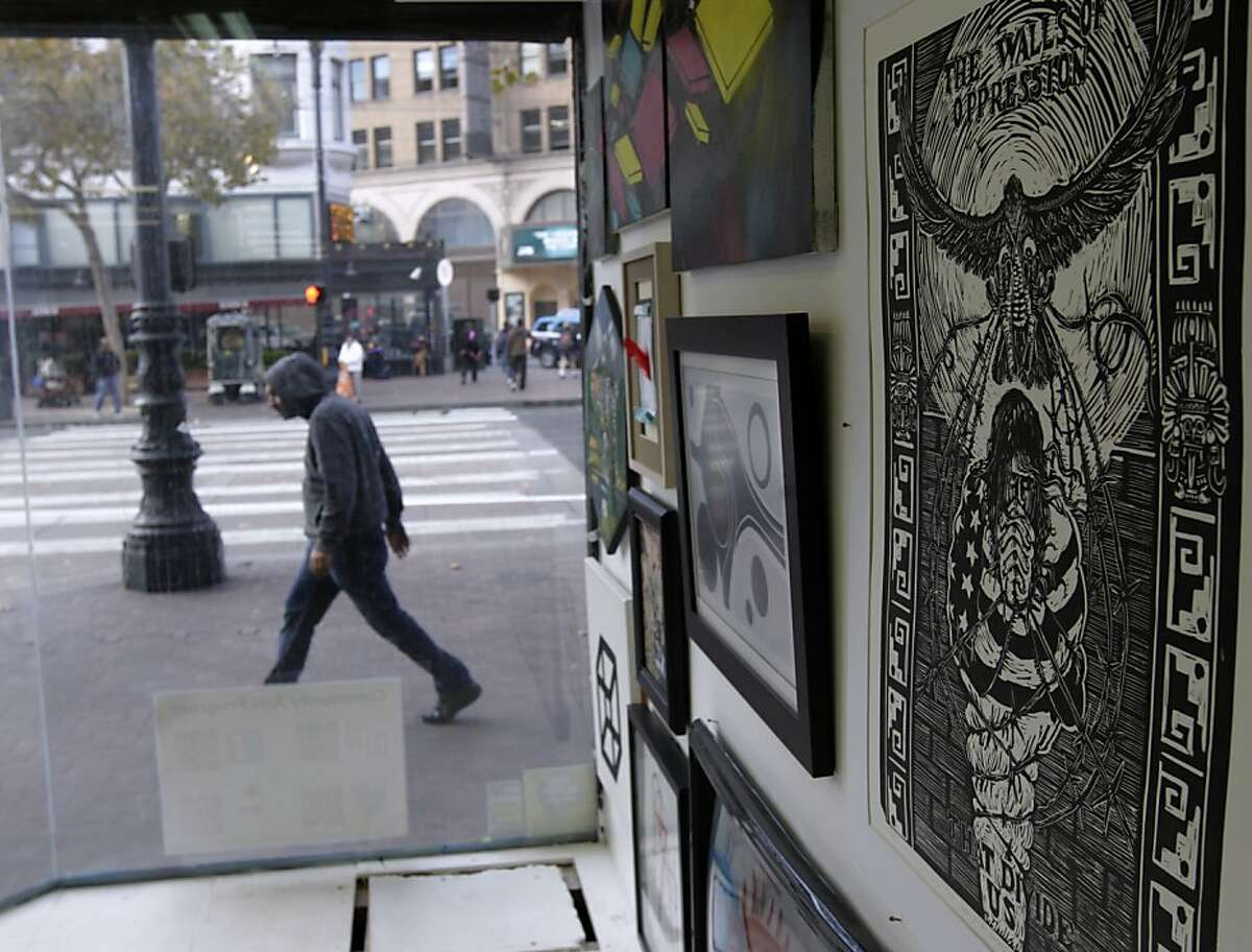 Artwork created by community residents are displayed in the storefront window of the Hospitality House Community Art Program studio in San Francisco, Calif. on Tuesday, Nov. 12, 2013. A nonprofit has stepped in to purchase the building and preserve the community arts programs in the mid-Market neighborhood.