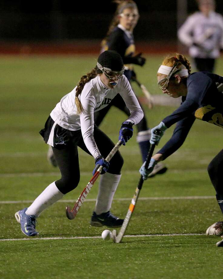 Darien High School's #2 Georgia Cassidy battles for the ball against Simsbury High School's #22 Sarah Franklin during the first half action at Tuesday evening Class L CIAC State Field Hockey Tournament. Photo: Mike Ross / Mike Ross Connecticut Post freelance - @www.mikerossphoto.com