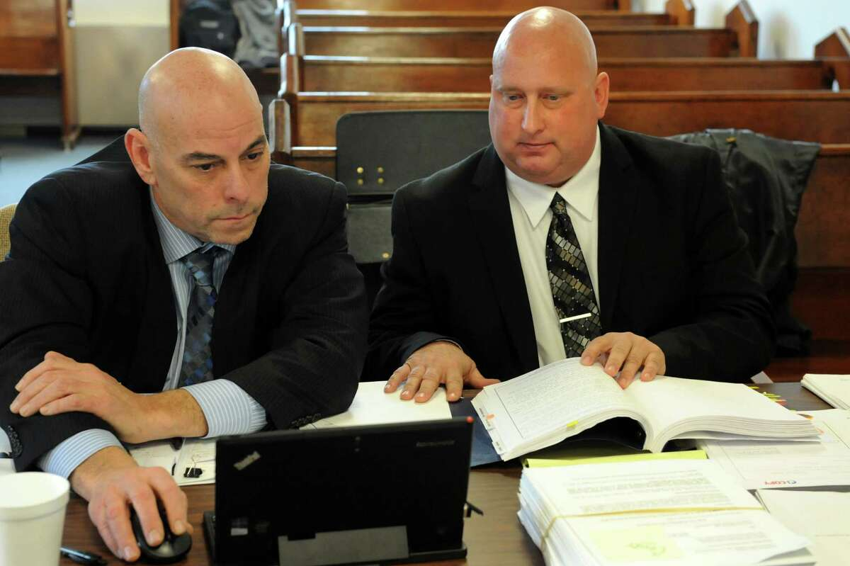 Albany Police Officer Brian Lutz, right, with his attorney David Brickman on Tuesday, Nov. 12, 2013, at Menands Village Court in Menands, N.Y. (Cindy Schultz / Times Union)