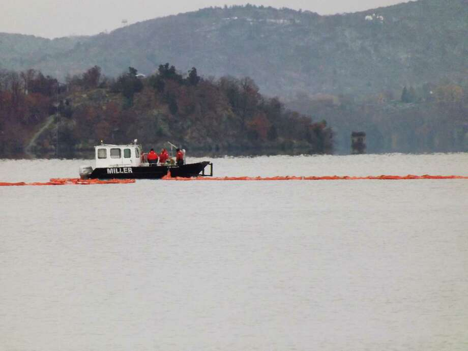 A floating containment boom is placed in the Hudson River during Tuesday's oil spill drill in Orange County.  (Brian Nearing/Times Union)