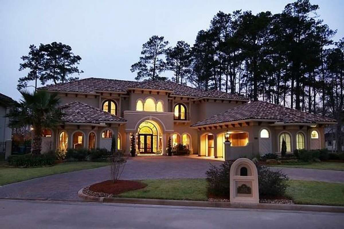 This beautiful Mediterranean home features a double-wide driveway.