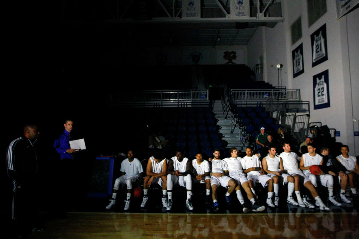 The Rice Owls wait on the bench after power went out in the Tudor Field House at Rice University Tuesday, Nov. 12, 2013, in Houston. The Owls were set to take on the Southeastern Louisiana Lions until the power went off just before tip off. Officials are working to determine the source.