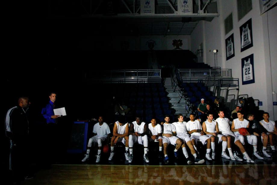 The Rice Owls wait on the bench after power went out in the Tudor Field House at Rice University Tuesday, Nov. 12, 2013, in Houston. The Owls were set to take on the Southeastern Louisiana Lions until the power went off just before tip off. Officials are working to determine the source. Photo: Cody Duty, Houston Chronicle / © 2013 Houston Chronicle