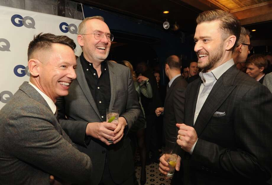 (L-R) GQ editor-in-chief Jim Nelson, GQ creative director Jim Moore, and musician/actor Justin Timberlake attend the GQ Men of the Year dinner on November 11, 2013 in New York City. Photo: Kevin Mazur, Getty Images For GQ