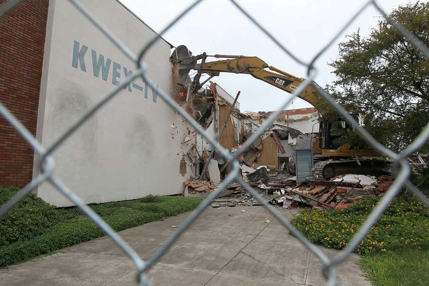 Heavy equipment is used to demolish the former Univision building after Judge Janet Littlejohn ruled to dissolve a temporary restraining order, Tuesday, Nov. 12, 2013. It cleared the way for demolition to continue. Developing company, Greystar, plans on building a $55-million 355-unit apartment on the site. Eight protesters were arrested trying to stop the demolition.