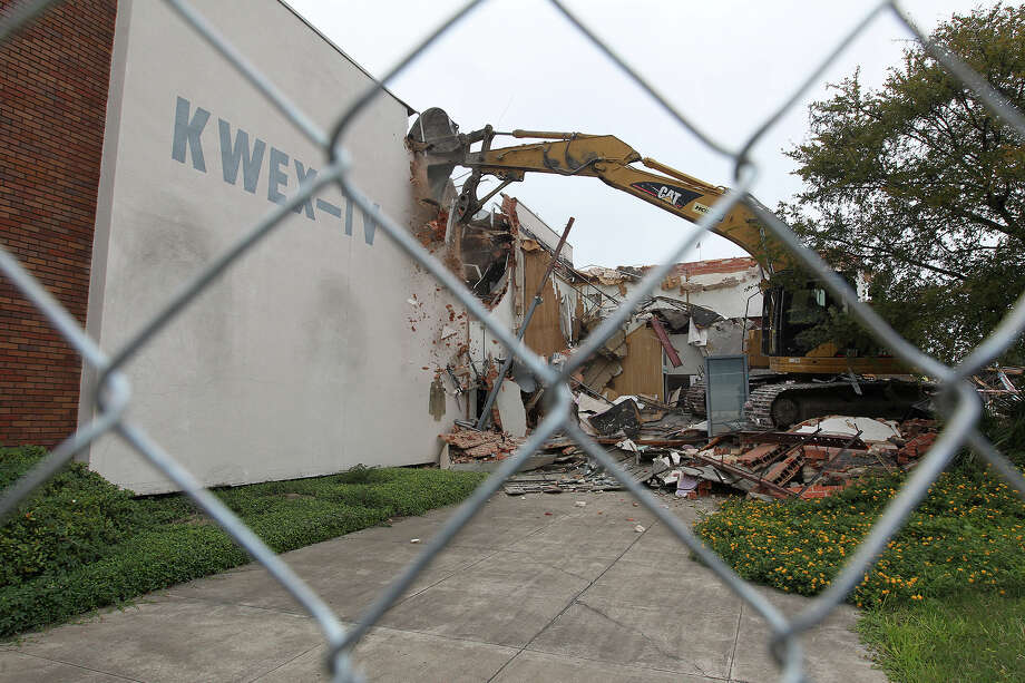 Heavy equipment is used to demolish the former Univision building after Judge Janet Littlejohn ruled to dissolve a temporary restraining order, Tuesday, Nov. 12, 2013.  It cleared the way for demolition to continue. Developing company, Greystar, plans on building a $55-million 355-unit apartment on the site. Eight protesters were arrested trying to stop the demolition. Photo: JERRY LARA, San Antonio Express-News / © 2013 San Antonio Express-News