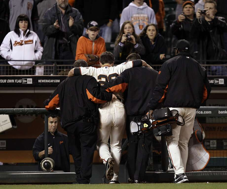 When Buster Posey left the field with a season-ending injury after a home-plate collision in 2011, MLB put the wheels in motion for a rule change to eliminate similar plays. Photo: Marcio Jose Sanchez, AP