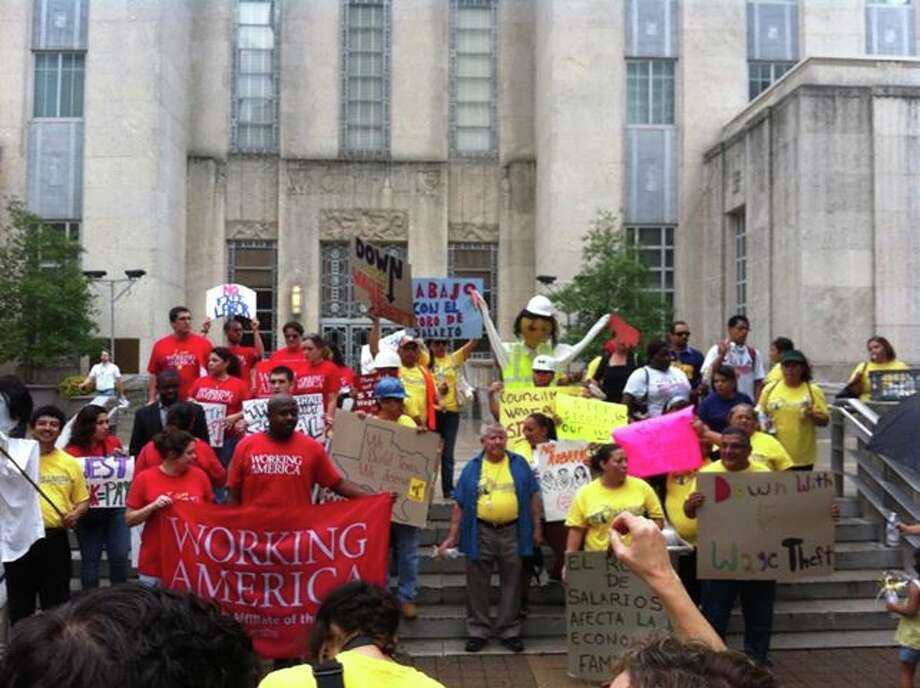 Members of the Houston Chapter of Working America advocate against stolen wages, which happens on a daily basis in Houston.
