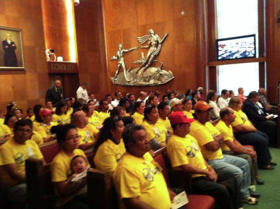 Houston workers gather at city hall to insist on their rights to be paid their full and due wages.