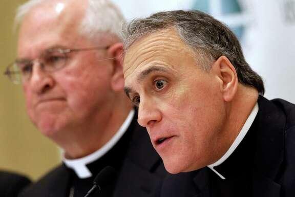 Cardinal Daniel DiNardo, right, and Archbishop Joseph Kurtz lead U.S. Catholic Bishops.