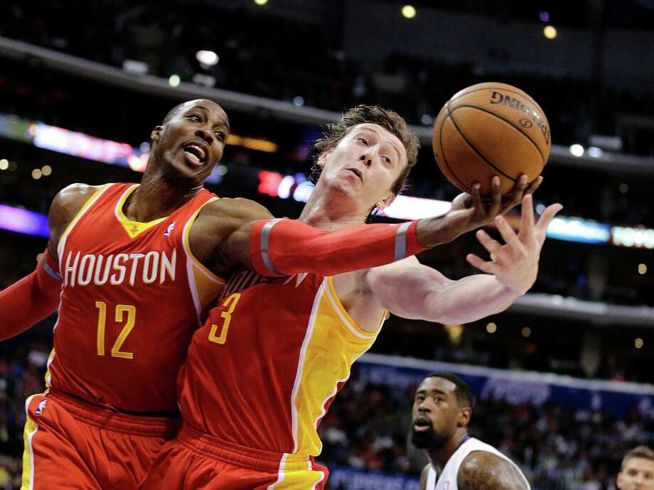 The Rockets are a better rebounding team with Dwight Howard, left, and Omer Asik on the floor together. Photo: Jae C. Hong, STF / AP