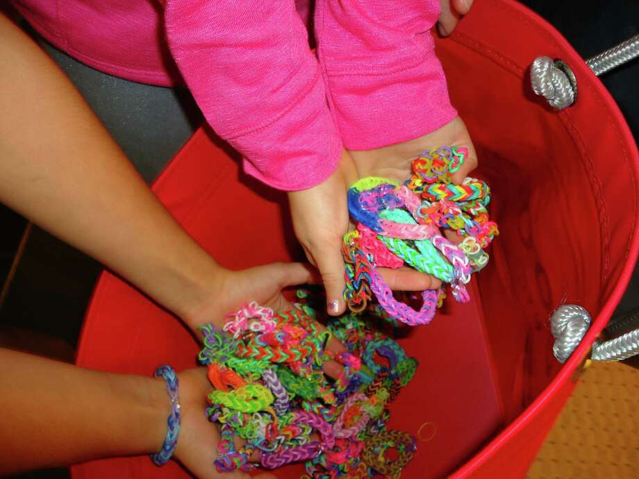 Karina Sethi, whose dad works at Greenwich Hospital, along with her fellow third graders at Riverside School made bracelets for hospital patients as a community service project. Photo: Contributed Photo / Greenwich Time contributed
