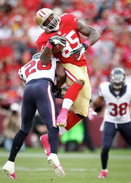 Ed Reed's stint with the Texans saw him make only 14 unassisted tackles, including this one of 49ers tight end Vernon Davis. Photo: Brett Coomer, Staff / © 2013  Houston Chronicle