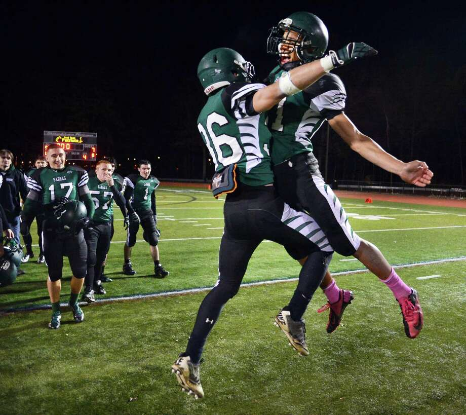 Schalmont's QB #36 Nick Gallo and #21 Devon Willis, at right, celebrate their Class B Super Bowl win against  Broadalbin-Perth at Shenendehowa High School Saturday Nov. 9, 2013, in Clifton Park, NY.  (John Carl D'Annibale / Times Union) Photo: John Carl D'Annibale / 00024546A