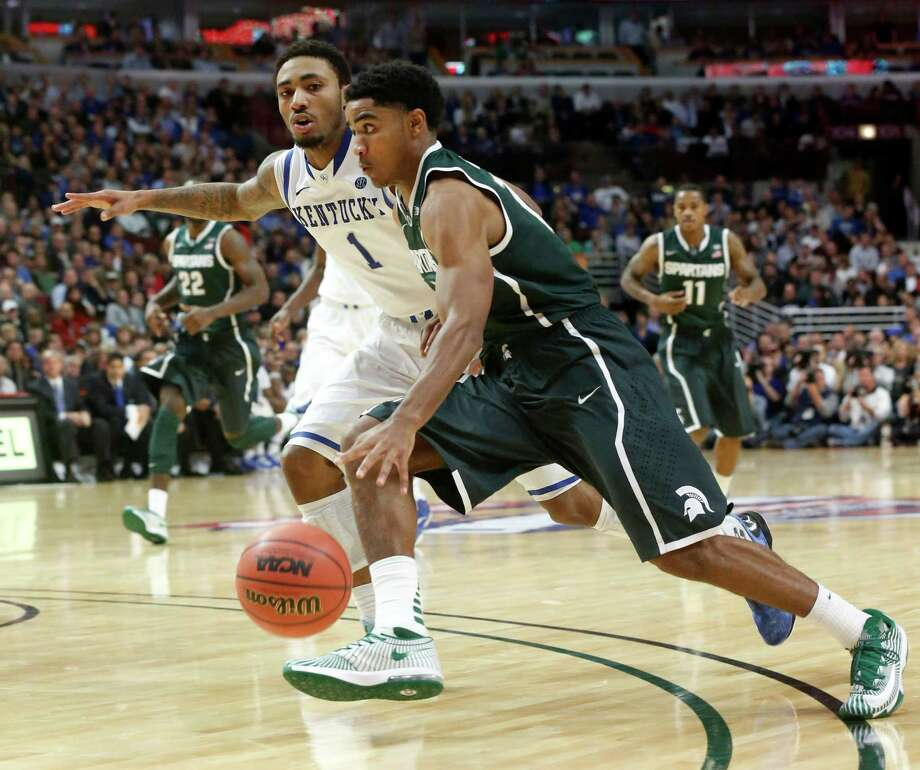 Michigan State guard Gary Harris drives on Kentucky guard James Young (1) during the second half of an NCAA college basketball game Tuesday, Nov. 12, 2013, in Chicago. Michigan State won 78-74. (AP Photo/Charles Rex Arbogast) ORG XMIT: CXA113 Photo: Charles Rex Arbogast / AP