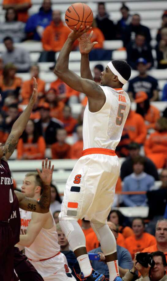 Syracuse's C. J. Fair shoots against Fordham during the first half of an NCAA college basketball game in Syracuse, N.Y., Tuesday, Nov. 12, 2013. (AP Photo/Kevin Rivoli) ORG XMIT: NYKR102 Photo: Kevin Rivoli / FR60349 AP