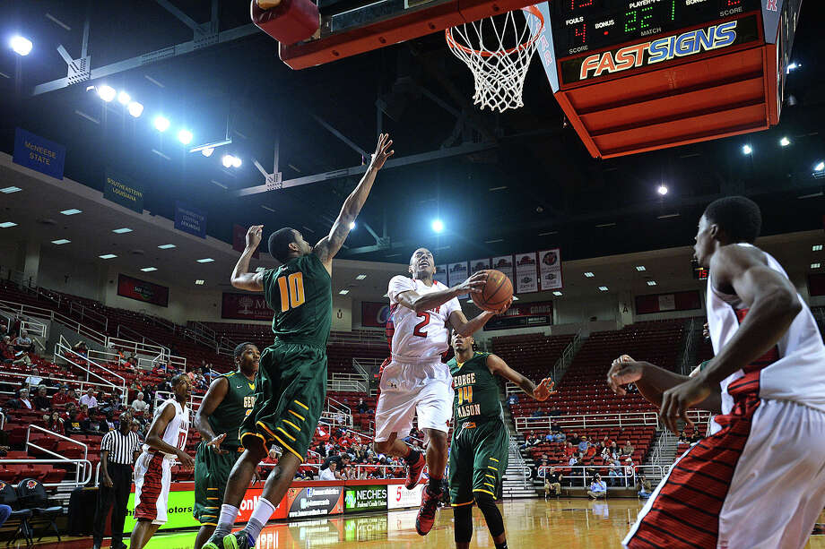 Lamar guard, Anthony Holliday goes up for a shoot during the mens basketball game against George Mason at Montagne Center, Wednesday. Michael Rivera/@michaelrivera88
