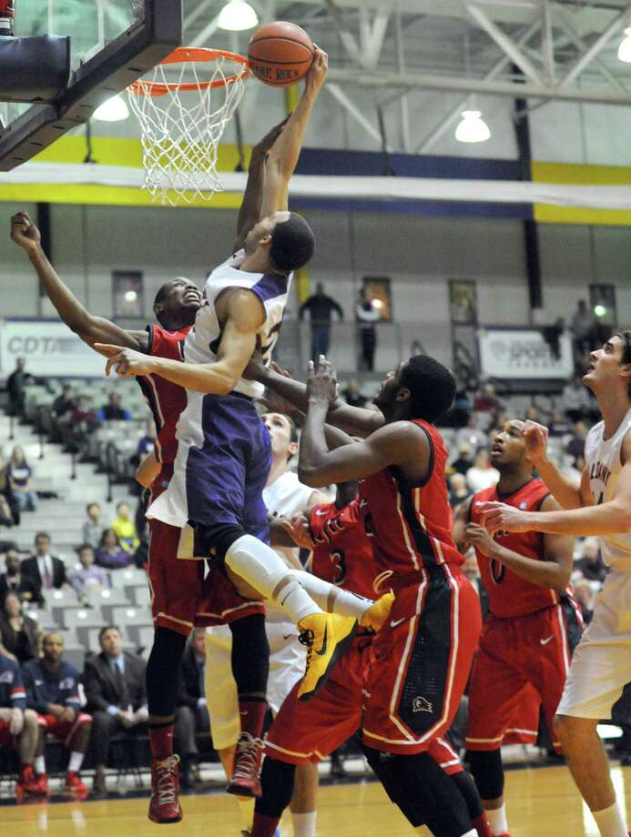 UAlbany's Gary Johnson goes to the basket during their men's college basketball game against NJIT at SEFCU arena on Tuesday Nov. 12, 2013 in Albany, N.Y.(Michael P. Farrell/Times Union) Photo: Michael P. Farrell / 00024601A
