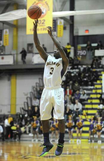 UAlbany's DJ Evans puts up a three point shot during their men's college basketball game against NJI