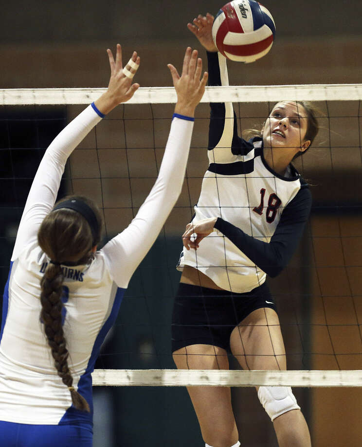 Churchill's Taylor Martinez delivers a spike in the Chargers' 21-25, 23-25, 25-18, 25-19, 15-12 victory over New Braunfels in a Region IV-5A quarterfinal match at Cole High School. Photo: Tom Reel / San Antonio Express-News