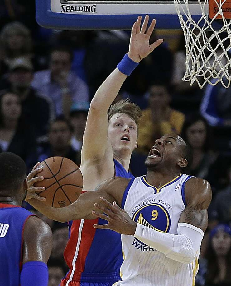 Golden State's Andre Iguodala looks for a way to get a shot off from near the basket against the Pistons' Kyle Singler. Photo: Ben Margot, Associated Press