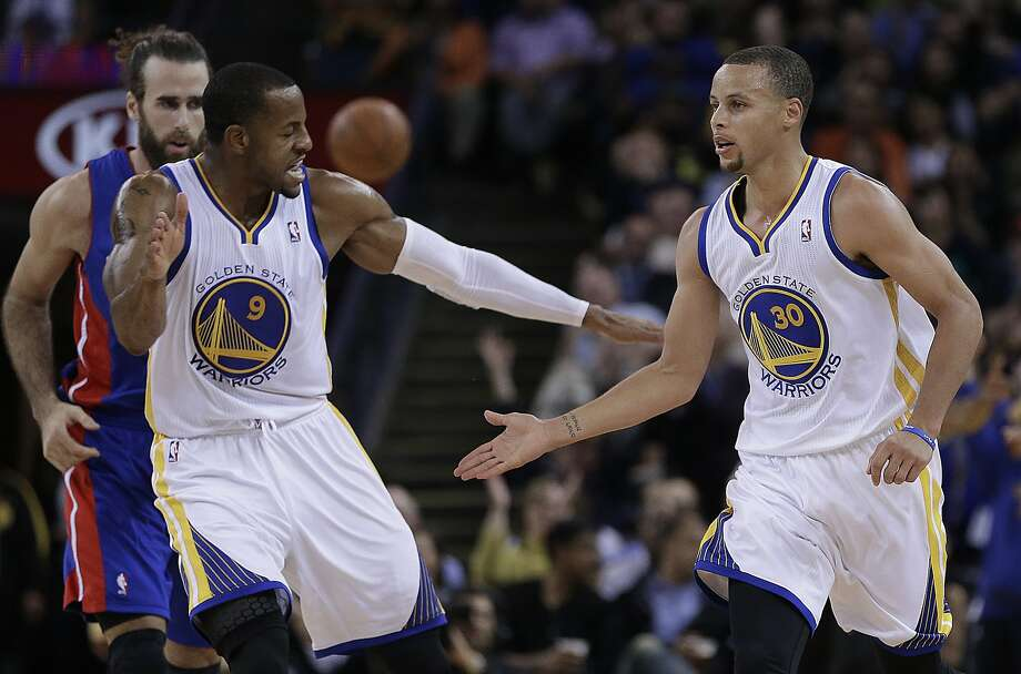 Golden State Warriors' Andre Iguodala (9) and Stephen Curry, right, celebrate a score by Curry against the Detroit Pistons during the second half of an NBA basketball game Tuesday, Nov. 12, 2013, in Oakland, Calif. (AP Photo/Ben Margot) Photo: Ben Margot, Associated Press