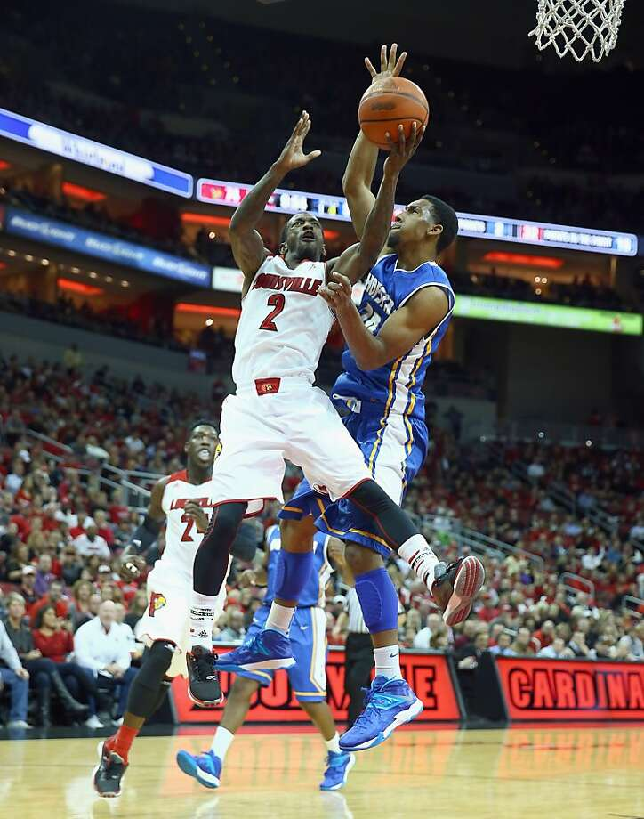Louisville's Russ Smith, who scored 30, drives on Hofstra's Jamall Robinson as the Cardinals cruised. Photo: Andy Lyons, Getty Images