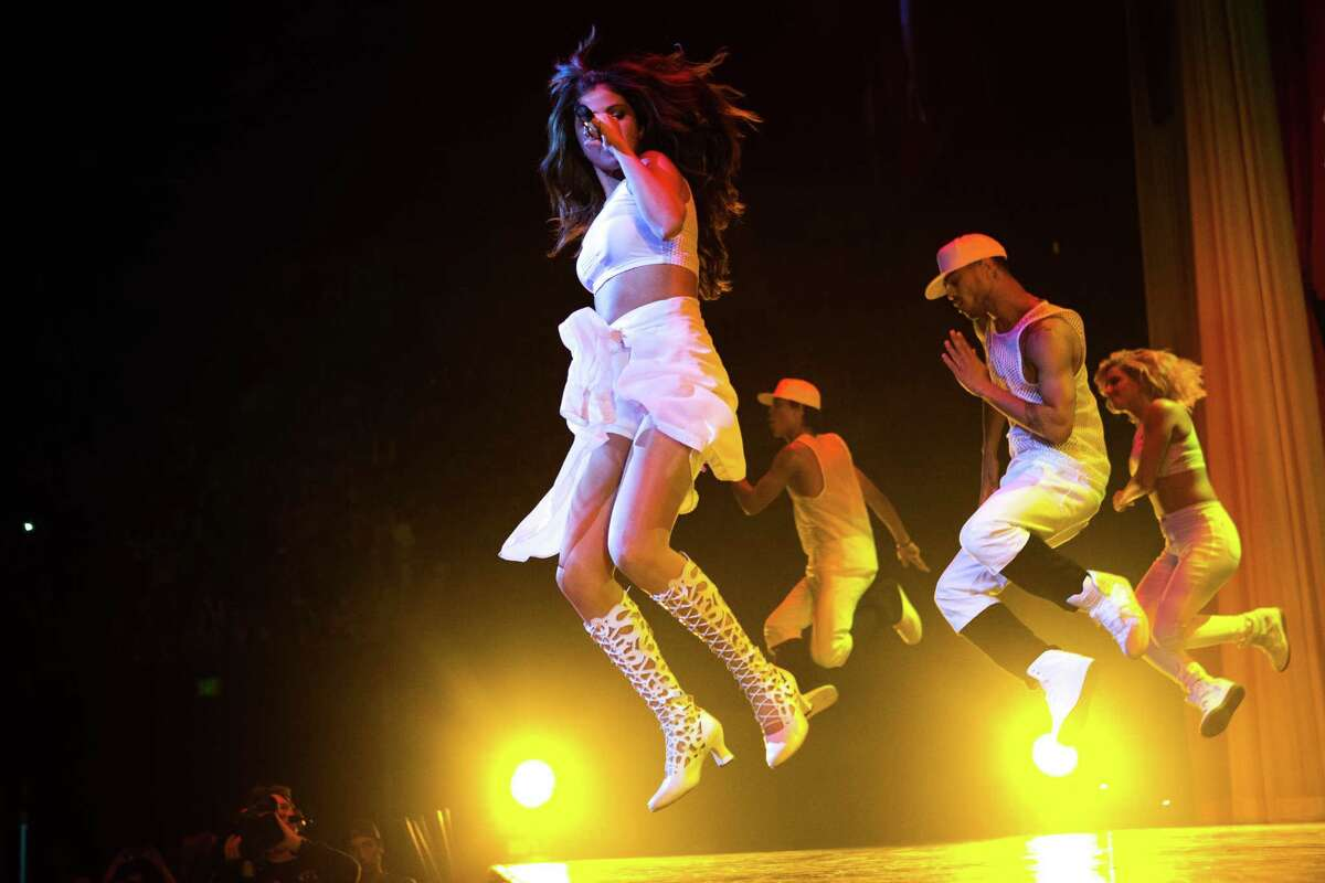 Selena Gomez performs for thousands of fans on Tuesday, November 12, 2013 at KeyArena in Seattle. The young pop star and actress performed as part of her