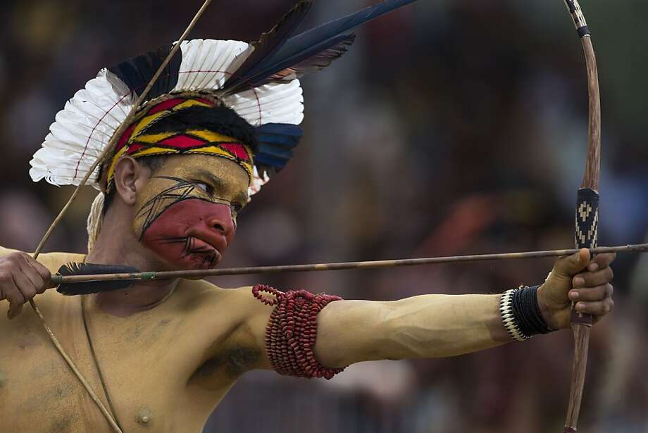 A Pataxo Indian takes part in the bow and arrow competition during the indigenous games in Cuiaba, Brazil, Tuesday, Nov. 12, 2013. Around 1,600 Indians from 48 tribes are celebrating Brazil's indigenous cultures during the 12th edition of the Games of the Indigenous People, which runs until Nov. 16. (AP Photo/Felipe Dana) Photo: Felipe Dana, Associated Press